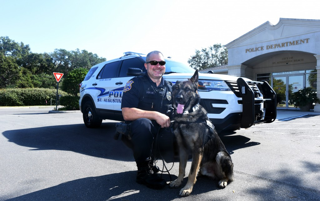 CHRISTINA.KELSO@STAUGUSTINE.COM K-9 Kilo with his handler Officer Bruce Cline, who he has lived and worked with for two weeks, on Thursday, Nov. 17, 2016 outside of the St. Augustine Beach Police Department office. As the department's new K-9 officer, K-9 Kilo will be used primarily to search for missing children on the beach as well as in community outreach.