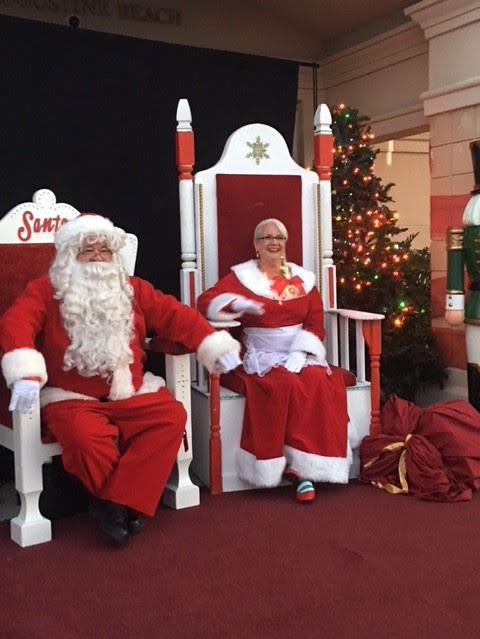 Cops with Claus event. Santa and Mrs. Claus